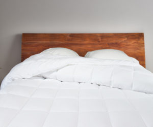 Comforter-with-wood-headboard-close-web